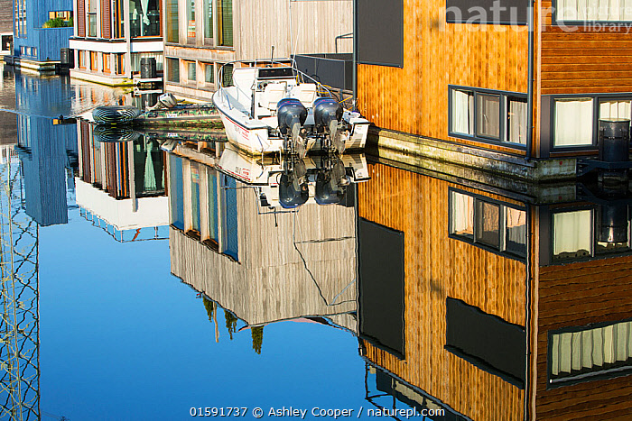 Floating houses in IJburg, Amsterdam, Netherlands, May 2013.  ,  Holland,Netherlands,Amsterdam,Ijburg,climate change,global warming,low lying,sea level,sea level rise,flooding,mitigation,house,housing,floating house,floating housing,innovative,innovation,engineering,solution,accomodation,design,architecture,mere,Ij Meer,polder,reclamation,reclaimed land,reflection,boat,,,,,, catalogue11  ,  Ashley Cooper