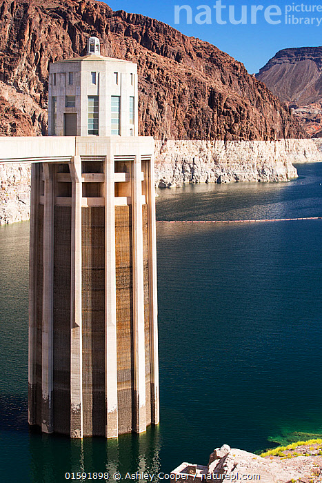 Intake towers for the hydro plant on the Hoover Dam, Lake Mead, Nevada, USA. The lake is at a very low level due to the four year long drought. September 2014., USA,US,America,Nevada,desert,Lake Mead,electricity,generating,renewable,renewable energy,carbon neutral,climate change,global warming,pylon,HEP,hydro,hydro power,drought,transmission,dam,dam wall,concrete,ravine,rock,geology,road,overspill,overflow,intake pipe,white,line,exposed,Hoover Dam,tower,,,,, Ashley Cooper