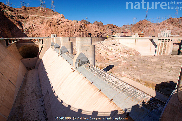 Overspill, standing high and dry at the Hoover Dam on Lake Mead,  following a four year long drought. Nevada, USA, September 2014.  ,  USA,US,America,Nevada,desert,Lake Mead,electricity,generating,renewable,renewable energy,carbon neutral,climate change,global warming,pylon,HEP,hydro,hydro power,drought,transmission,dam,dam wall,concrete,ravine,rock,geology,road,overspill,overflow,intake pipe,white,line,exposed,Hoover Dam,tower,,,,  ,  Ashley Cooper