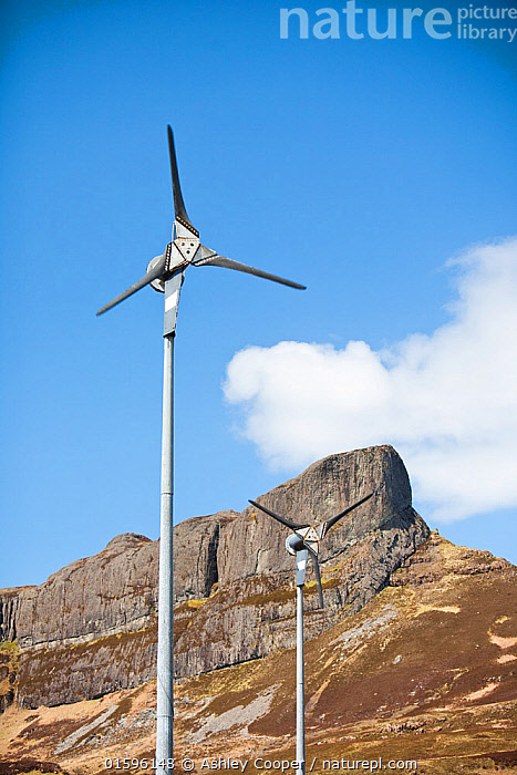 Wind turbines beneath An Sgurr, Isle of Eigg. Isle of Eigg produces all the energy the island needs from renewable energy. Eigg, Scotland, UK, May., Eigg,island,Scotland,UK,Eigg Heritage Trust,community,energy,power,electric,electricity,renewable,renewable energy,renewable power,wind power,solar power,hydro,hydro power,clean,green,zero emissions,climate change,global warming,carbon footprint,feed in tariff,future,Eigg electric,self sufficient,self sufficiency,lifestyle,environment,eco,An Sgurr,peak,promontary,icon,iconic,wind turbine,windy,exposed,location,position,,,Europe,Western Europe,UK,Equipment,Power Equipment,Turbine,Wind Turbine,, Ashley Cooper