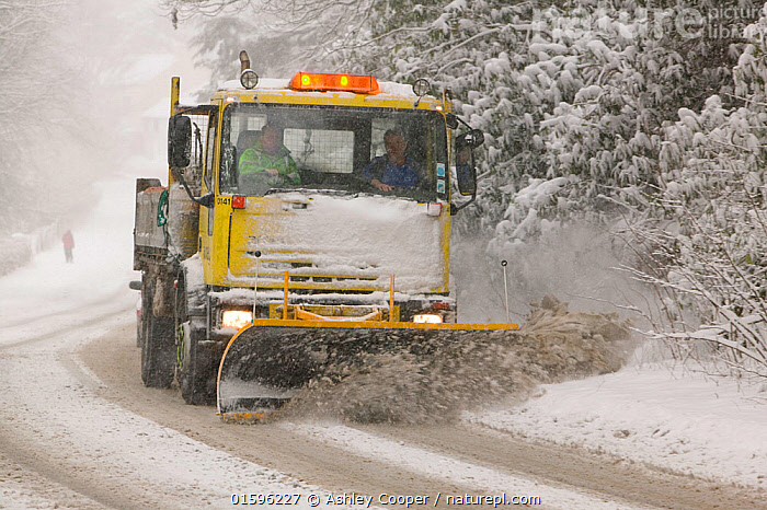 A snow plough driving in heavy snow, clearing the road  in Ambleside, England, UK. March 2006  ,  snow,snowy,snowing,snow fall,heavy,winter,weather,cold,frosty,extreme,hazard,hazardous,treacherous,danger,dangerous,risk,risky,difficult,slippy,skid,sliding,car,driving,driver,transport,challenge,road,Ambleside,Cumbria,Lake district,UK,season,precipitation,blizzard,poor visibility,windscreen wipers,lights,headlights,snow plough,clearing,,,Europe,Western Europe,UK,Weather,Bad Weather,Severe weather,  ,  Ashley Cooper