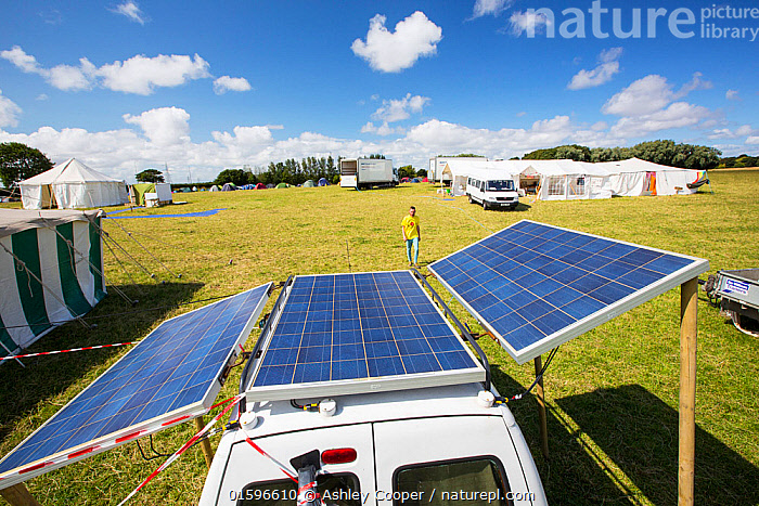 Van with solar panels attached at a protest against fracking at a farm site at Little Plumpton, near Blackpool, Lancashire, UK, where the council for the first time in the UK, has granted planning permission for commercial fracking fro shale gas, by Cuadrilla. August 2014  ,  fracking,frack,gas,shale gas,energy,power,drilling,protest,banner,anti,camp,protest camp,environment,environmentalist,green,politics,planning permission,Lancashire,UK,Fylde,Blackpool,Little Plumpton,farmland,colourful,protesting,campaign,climate change,global warming,pollution,destruction,health,future,tent,movement,placard,Cuadrilla,renewable energy,yellow,solar power,solar panel,PV,photo voltaic,off grid,truck,lorry,electricity,carbon neutral,car,van,novel,inventive,home made,south facing,sky,querky,,,Environment,Environmental Issues,Power supply,Sustainable power,Energy,Solar power,  ,  Ashley Cooper