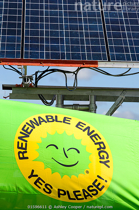 Truck with solar panels attached at a protest against fracking at a farm site at Little Plumpton near Blackpool, Lancashire, UK, August 2014  ,  fracking,frack,gas,shale gas,energy,power,drilling,protest,banner,anti,camp,protest camp,environment,environmentalist,green,politics,planning permission,Lancashire,UK,Fylde,Blackpool,Little Plumpton,farmland,colourful,protesting,campaign,climate change,global warming,pollution,destruction,health,future,tent,movement,placard,Cuadrilla,renewable energy,yellow,solar power,solar panel,PV,photo voltaic,off grid,truck,lorry,electricity,carbon neutral,,,Environment,Environmental Issues,Power supply,Sustainable power,Energy,Solar power,  ,  Ashley Cooper