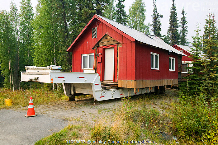 House in Fairbanks Alaska moved after it started collapsing into the ground due to global warming induced permafrost melt. August 2004  ,  collapse,permafrost,melting,global,warming,climate,change,Fairbanks,Alaska,abandoned,warming,sinking,collapse,housing,melting,permafrost,methane,Co2,warming,climate,trailer,move,,,,  ,  Ashley Cooper
