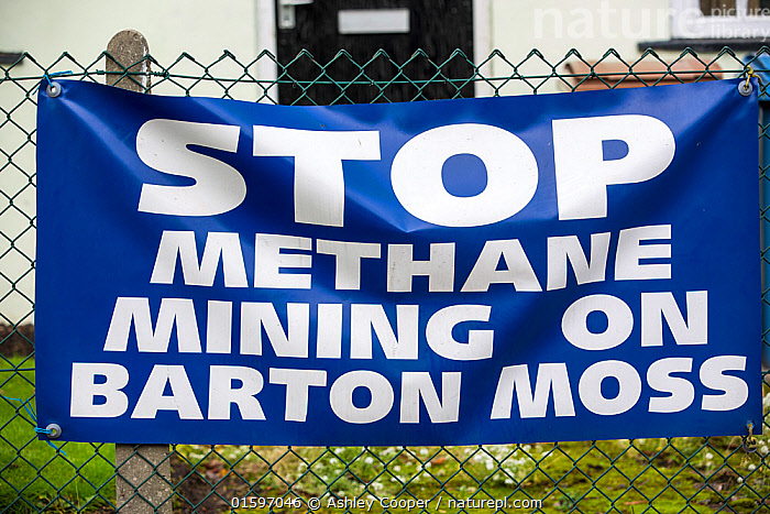 'Stop Methane Mining on Barton Moss' sign on Chat Moss peat bog, to protest planning permission for fracking and coal bed methane mining, Manchester, England, UK. November 2013.  ,  Manchester,UK,Barton Moss,Chat Moss,house,banner,protest,anti,fracking,methane,gas,greenhouse,fossil fuel,power,energy,geology,shale gas,mining,drilling,CBM,coal bed methane,coalbed methane,greenbelt,green belt,,,,  ,  Ashley Cooper