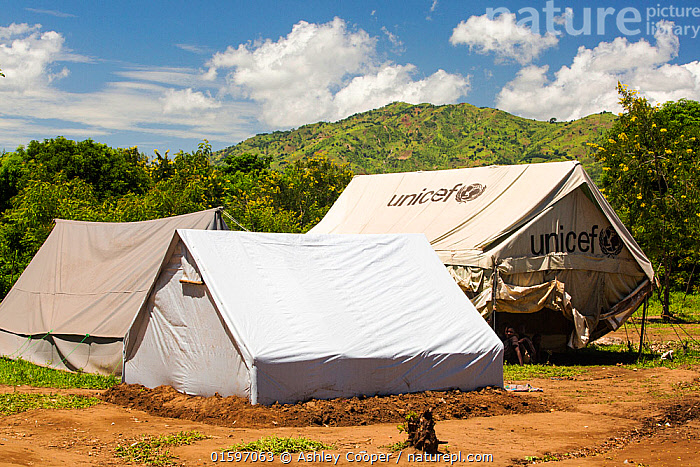 Refugee camp tents for people displaced by flooding in January 2015, Shire Valley near Chikwawa, Malawi, March 2015.  ,  Malawi,Africa,Chiteskesa,refugee camp,flood,floods,flooding,displaced,charity,NGO,aid,African,disaster,disaster relief,climate change,global warming,refugee,poor,poverty,sunlight,Unicef,tent,shelter,Shire Valley,,,,  ,  Ashley Cooper