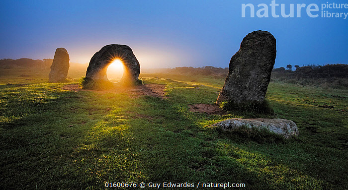 Sunrise through stone at Men-An-Tol, Morvah, Cornwall, England, UK. September 2016., Morning,Mornings,Ancient,Shape,Circle,Europe,Western Europe,UK,Great Britain,England,Cornwall,Back Lit,Monument,Monuments,Megalithic Monument,Megalithic Monuments,Standing Stone,Standing Stones,Sunlight,Light Ray,Rock,Stone,Stones,Sunrise,Landscape,History,Dawn,Prehistoric,The Past,Natural Light,Neolithic,,, catalogue11, Guy Edwardes