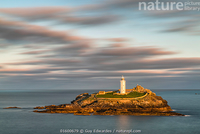 Godrevy Lighthouse, St Ives, Cornwall, England, UK. September 2015.  ,  Morning,Mornings,Europe,Western Europe,UK,Great Britain,England,Cornwall,Copy Space,Building,Lighthouse,Lighthouses,Cliff,Island,Islands,Rock,Ocean,English Channel,The English Channel,Atlantic Ocean,Landscape,Coast,Marine,Coastal,Water,Saltwater,Sea,Negative space,  ,  Guy Edwardes