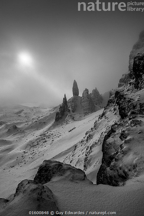 The Old Man of Storr in winter, Trotternish Peninsula, Isle of Skye, Inner Hebride, Scotland, UK. January 2015.  ,  Temperature,Cold,Europe,Western Europe,UK,Great Britain,Scotland,Copy Space,Monochromatic,Mountain,Rock Formations,Snow,Landscape,Winter,Geology,Hebrides,Inner Hebrides,Skye,Scottish islands,Scottish isles,Isle of Skye,Negative space,Landform,  ,  Guy Edwardes