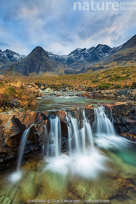 Fairy Pools with Black Cuillin mountains in background, Isle of Skye, Inner Hebrides, Scotland, UK. January 2014., Flowing,Flow,Europe,Western Europe,UK,Great Britain,Scotland,Photographic Effect,Long Exposure,Mountain,Mountain Range,Mountain Ranges,Range,Rock,Flowing Water,Waterfall,River,Landscape,Freshwater,Water,Hebrides,Inner Hebrides,Skye,Scottish islands,Scottish isles,Isle of Skye,Upland,Uplands,, Guy Edwardes