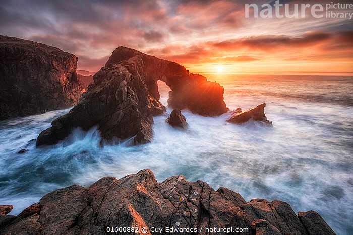 Stac a' Phris rock arch, Isle of Lewis, Outer Hebrides, Scotland, UK. March 2017., Erosion,Europe,Western Europe,UK,Great Britain,Scotland,Photographic Effect,Long Exposure,Cliff,Rock Formations,Arch,Arches,Rock,Ocean,Atlantic Ocean,Sunset,Setting Sun,Sunsets,Landscape,Coast,Marine,Coastal,Water,Geology,Saltwater,Sea,Dusk,Isle of Lewis,Landform,, Guy Edwardes