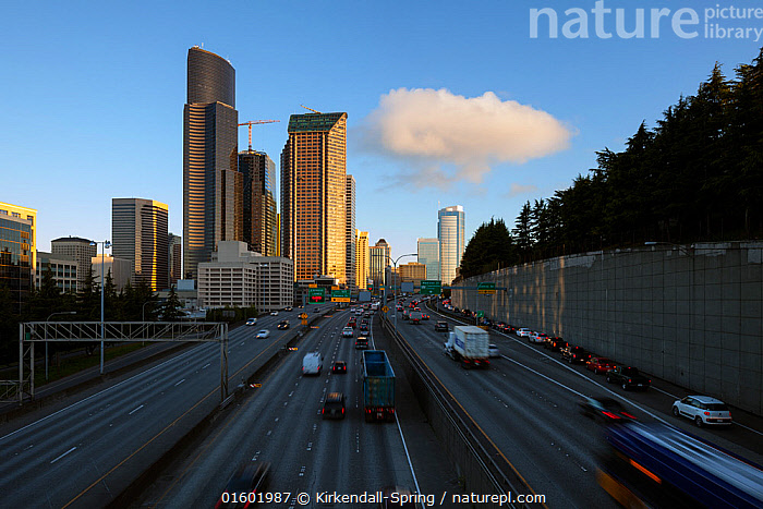 Interstate 5 and the Seattle skyline viewed from the Yesler Way overpass at sunrise.  Washington, USA. April 2017., American,North America,USA,Western USA,Washington,City,Skyline,Skylines,Road,Land Vehicle,Motor Vehicle,Sky,Cloud,Cityscape,American,Car,Automobile,United States of America,, Kirkendall-Spring