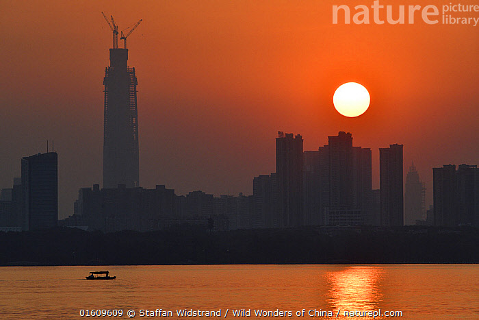 Sunset skyline of Wuhan, East Lake Greenway park, Wuhan, Hubei, China, Asia,East Asia,China,Back Lit,City,Skyline,Skylines,Building,Skyscraper,Skyscrapers,Reflection,Cityscape,Water,Silhouette,The Sun,, Staffan Widstrand / Wild Wonders of China