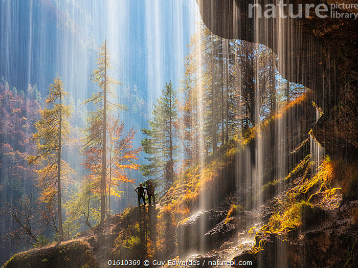 View of hikers from behind the Pericnik Waterfall, Slovenia, October 2018., Autumn,Cascade,Europe,Guy Edwardes,Horizontal,Julian Alps,Pair,People,Pericnik Waterfall,Slovenia,Triglav National Park,Two,Water,Waterfall,Wet,fall,figures,foliage,spray,,,People,Europe,Southern Europe,Slovenia,Photographic Effect,Long Exposure,Plant,Tree,Mountain,Flowing Water,Waterfall,Landscape,Autumn,Hikers,Freshwater,Water,Forest,,, catalogue11, Guy Edwardes