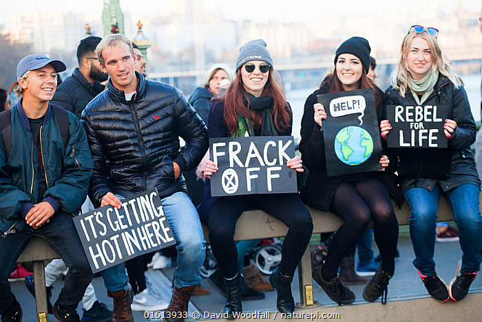 Protestors holding placards during Extinction Rebellion demonstration. Five bridges across the Thames were blocked to draw attention to climate change. Westminster, London, England, UK. November 2018.  ,  People,Woman,Man,Protestor,Demonstrater,Demonstraters,Demonstrator,Demonstrators,Protester,Protesters,Protestors,Environmental Protestor,Environment Protester,Environment Protesters,Environmental Protestors,Environmentalist,Environmentalists,Campaign,Campaigning,Protests,Rally,Rallies,Europe,Western Europe,UK,Great Britain,England,London,Greater London,Inner London,Westminster,Information,Banner,Banners,Placards,Environment,Environmental Issues,Global Warming,Greenhouse Effect,Direct action,Climate change,Demonstration,Demonstrations,  ,  David  Woodfall