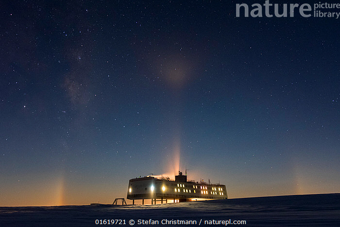 Milky way and moonbow halo during polar night. Above Neumayer-Station III, Alfred-Wegener-Institut research station, Atka Bay, Antarctica. June 2017., Research,Researching,Antarctica,Antarctic,Polar,Building,Place Of Research,Research Facility,Research Facilities,Outer Space,The Universe,Galaxy,Galaxies,Moon,Ice,Winter,Night,Science,Milky Way,Queen Maud Land,Atka Bay,Polar night,, Stefan Christmann