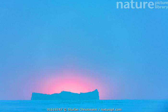 Sea ice and iceberg during polar night. Atka Bay, Antarctica. July 2017.  ,  Antarctica,Antarctic,Polar,Copy Space,Sky,Skyscapes,Ice,Iceberg,Icebergs,Landscape,Winter,Negative space,Sea ice,Queen Maud Land,Atka Bay,,catalogue12  ,  Stefan Christmann