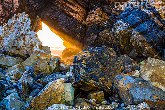 Last rays of the sun through a hole in a Seastack with the Atlantic Ocean in the background. Sintra coast, Portugal, December  ,  December,Europe,Southern Europe,Portugal,Sunlight,Light Ray,Ocean,Atlantic Ocean,Wave,Coast,Marine,Coastal,Water,Arty shots,Saltwater,Natural Light,  ,  Theo  Bosboom