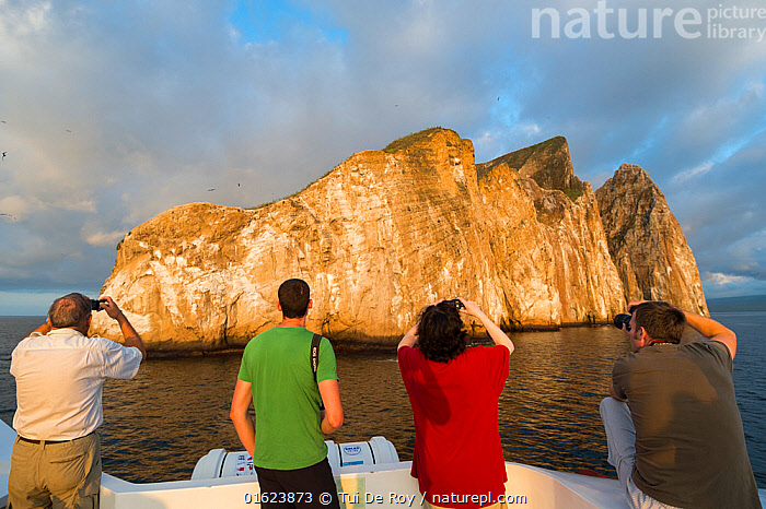 Tourists taking pictures of Kicker Rock, San Cristobal Island, Galapagos. April 2013.  ,  Capturing An Image,Photographing,People,Tourist,Tourists,Latin America,South America,Galapagos Islands,Galapagos,Photography,Ocean,Pacific Ocean,Travel,Tourism,Marine,Water,Saltwater,Biodiversity hotspot,Galapagos National Park,UNESCO World Heritage Site,  ,  Tui De Roy