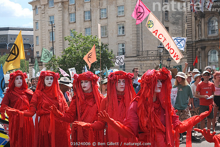 The Red Brigade performance artists on Extinction Rebellion climate change protest march. Bristol, England, UK. 16 July 2019., People,Woman,Entertainment Occupation,Entertainment Occupations,Performer,Performers,Protestor,Demonstrater,Demonstraters,Demonstrator,Demonstrators,Protester,Protesters,Protestors,Colour,Red,Group,Group Of People,Campaign,Campaigning,Protests,Rally,Rallies,Europe,Western Europe,UK,Great Britain,England,Bristol,Clothing,Dressing Up,Costume,Environment,Environmental Issues,Global Warming,Greenhouse Effect,Direct action,Climate change,Demonstration,Demonstrations,, Ben Gillett