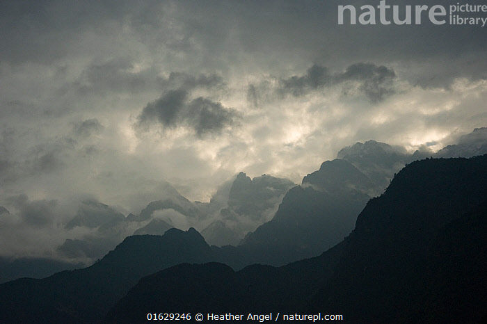 Peaks and clouds above Tiger Leaping Gorge at dawn. Three Parallel Rivers of Yunnan Protected Areas World Heritage Site, Yunnan Province, China. 2010., Morning,Mornings,Asia,East Asia,China,Back Lit,Mountain,Mountain Range,Mountain Ranges,Range,Sky,Cloud,Moody Sky,Weather,Storm,Landscape,Bad Weather,Silhouette,Severe weather,Protected area,UNESCO World Heritage Site,Dawn,Yunnan Province,Three Parallel Rivers of Yunnan Protected Areas,Parallel Rivers,Tiger Leaping Gorge,, Heather Angel