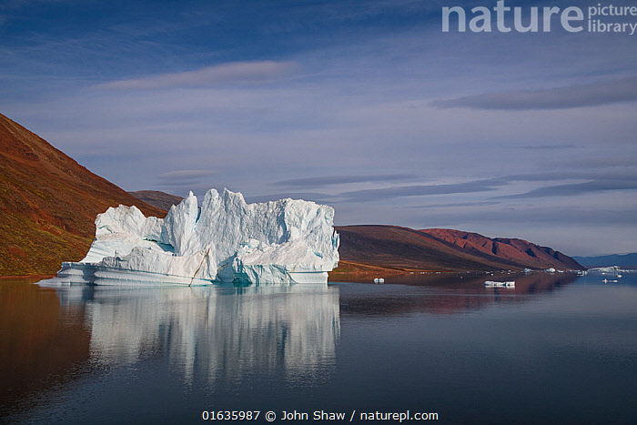 Iceberg in Rode Fjord (Red Fjord), Scoresby Sund, Greenland, August.  ,  Reflection,Ice,Iceberg,Icebergs,Ocean,Arctic Ocean,Coast,Marine,Coastal,Water,Saltwater,Kalaallit Nunaat,Greenland Sea,Scoresby Sund,Catalogue13,Catalogue13  ,  John Shaw