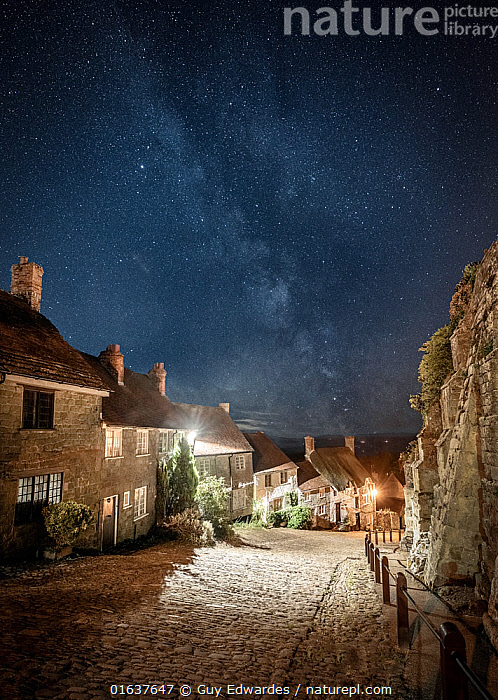 Gold Hill at night, with the Milky Way above, Shaftesbury, Dorset, England, UK, August 2018.  ,  Natural Science,Astronomy,Europe,Western Europe,UK,Great Britain,England,Dorset,Vertical,Settlement,Town,Towns,Paving,Paved,Cobble,Cobbled,Cobbles,Cobblestone,Cobblestones,Outer Space,The Universe,Galaxy,Galaxies,Stars,Landscape,Night,Nocturnal,Milky Way,  ,  Guy Edwardes