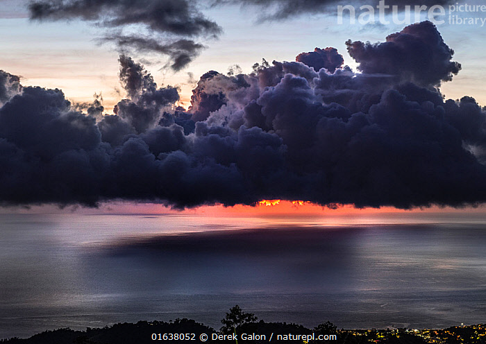 Dramatic sunset with storm clouds over Roseau, Caribbean sea view in Dominica, Lesser Antiles. September 2019.  ,  Catalogue13,Mood,Ominous,Foreboding,The Caribbean,Caribbean,West Indies,Sky,Cloud,Storm Cloud,Sunset,Setting Sun,Sunsets,Biodiversity hotspots,Dusk,Dramatic,Dominica,Catalogue13,Moods,Skies,Clouds,Storm Clouds  ,  Derek Galon