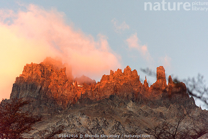 Cerro Castillo Mountain with sunset light on clouds, Cerro Castillo National Park, Patagonia, Chile. January 2017.  ,  Latin America,South America,Chile,Patagonia,Mountain,Summit,Sunlight,Sky,Cloud,Sunset,Setting Sun,Sunsets,Reserve,Protected area,National Park,Dusk,Natural Light,  ,  Rhonda Klevansky