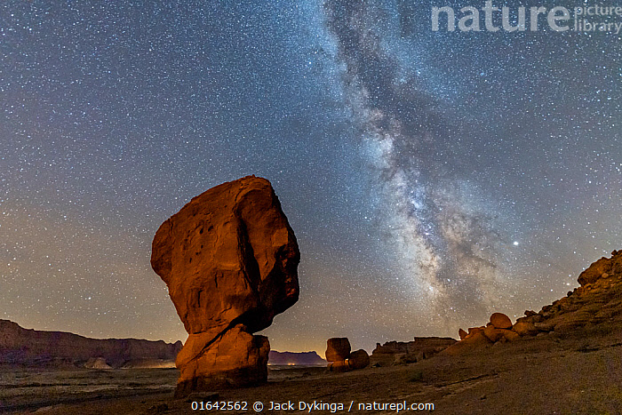 Cap-rock formations near the Colorado River, Echo Cliffs in background. Milky Way over boulders at base of the Vermilion Cliffs. Glen Canyon National Recreation Area, Arizona, USA. September 2019.  ,  American,North America,USA,Western USA,Southwest USA,Arizona,Photographic Effect,Long Exposure,Rock Formations,Outer Space,The Universe,Galaxy,Galaxies,Stars,Rock,Sandstone,Landscape,Night,Geology,Milky Way,Recreation Area,American,United States of America,Landform,Catalogue13,Glen Canyon National Recreation Area,Catalogue13  ,  Jack Dykinga