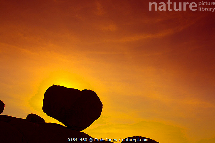 Huge boulder balanced on rocky outcrop at sunset, Namib desert, Namib-Naukluft National Park, Namibia, March  ,  Empty,Colour,Orange,Yellow,Dry,Arid,Africa,Southern Africa,Namibia,South-West Africa,Back Lit,Desert,Namib Desert,Sunset,Setting Sun,Sunsets,Silhouette,Dusk,Namibian,Expansive,  ,  Ernie Janes
