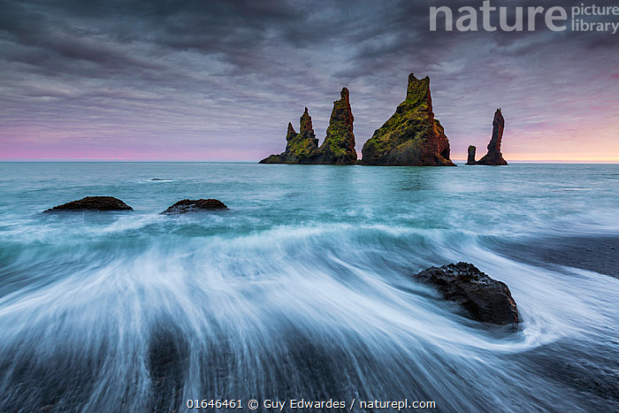 Reynisdrangur stacks with long exposure of waves,, Vik i Myrdal, Iceland, September 2015.  ,  Europe,Northern Europe,North Europe,Nordic Countries,Scandinavia,Iceland,Photographic Effect,Long Exposure,Rock Formations,Sands,Black Sands,Ocean,Arctic Ocean,Wave,Landscape,Coast,Marine,Coastal,Water,Geology,Saltwater,Sea,Landform,Catalogue13,Catalogue13  ,  Guy Edwardes