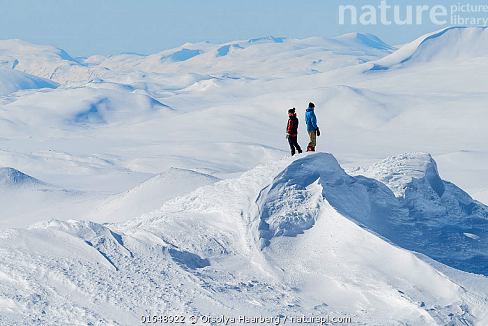 Photographers in snow-covered mountain landscape. Orsolya Haarberg and Erlend Haarberg. Vaga, Norway. March 2020.  ,  Erlend Haarberg,Landscape,March,Mountain,Norway,Orsolya Haarberg,Skaihoe,Vaagaa,Winter,Fjell,Mountainscape,,,Mood,Calm,Europe,Northern Europe,North Europe,Nordic Countries,Scandinavia,Norway,Mountain,Snow,Landscape,Spring,,,catalogue14,People  ,  Orsolya Haarberg