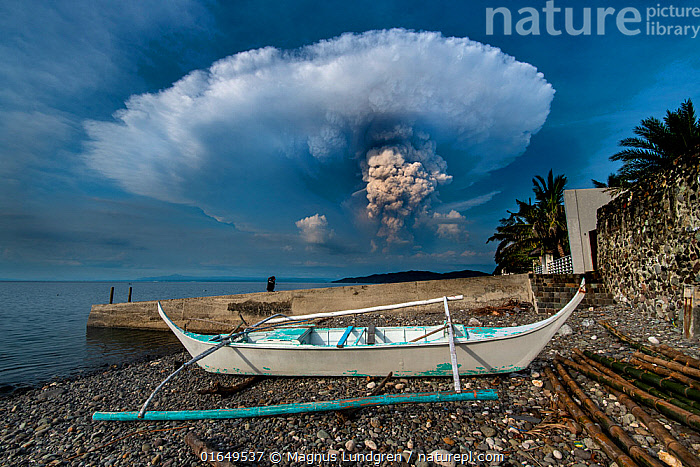 Eruption of Taal Volcano viewed from Anilao in Batangas, Philippines. January 12, 2020 Minimum fees apply.  ,  Erupting,Asia,South East Asia,Republic of the Philippines,Boat,Tropical,Volcano,Ocean,Pacific Ocean,Landscape,Coast,Marine,Coastal,Water,Geology,Volcanic features,Open boat,Outrigger,Saltwater,Biodiversity hotspots,Biodiversity hotspot,Philippines,Interesting,  ,  Magnus Lundgren