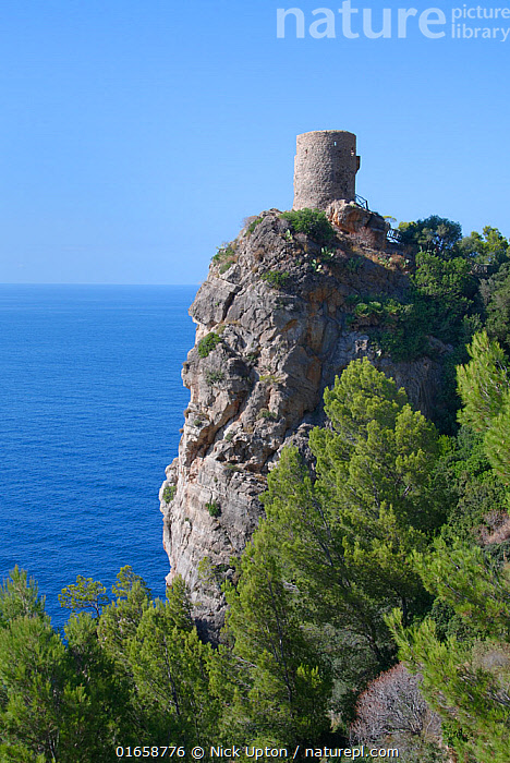 Torre Verger medieval watchtower on a high coastal cliff top at the Mirador de Ses Animes, near Banyalfufar, Mallorca north coast, August 2018.  ,  Styles,Medieval,Balearic Islands,Majorca,Europe,Southern Europe,Spain,Building,Tower,Towers,Watch Tower,Guard Tower,Guard Towers,Watch Towers,Sky,Mediterranean Sea,History,Coast,Marine,Coastal,Water,Saltwater,Sea,Mediterranean,Blue sky,The Past,  ,  Nick Upton