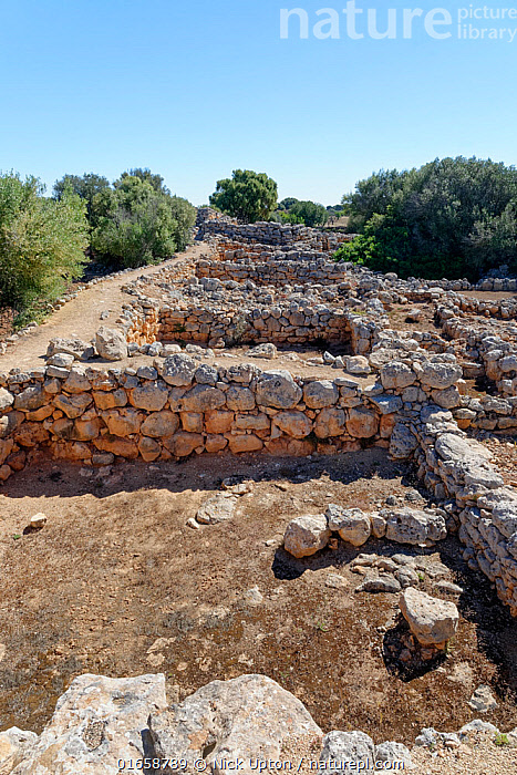 Ruins of ancient stone houses at Capocorb Vell, a much excavated settlement built by the Talaiotic culture, which flourished in Mallorca between around 1300 and 800 BC, near Cala Pi, Mallorca. May 2019.  ,  Balearic Islands,Majorca,Europe,Southern Europe,Spain,Ruins,Ruin,Landscape,History,The Past,  ,  Nick Upton