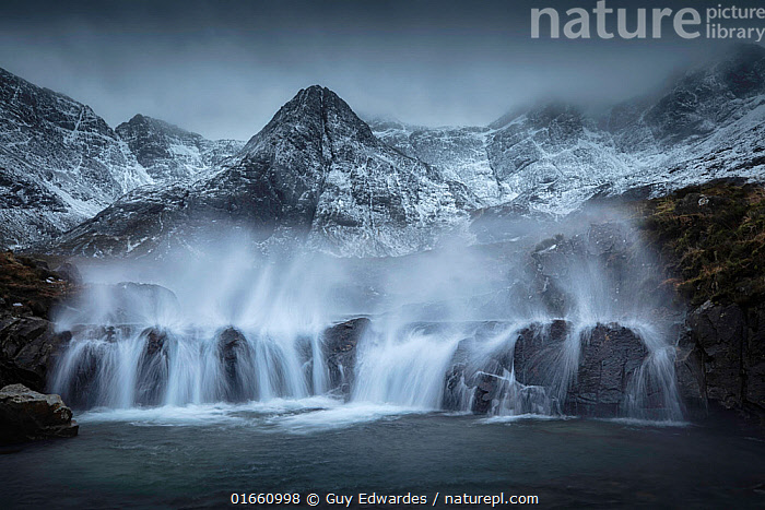 Fairy Pools during Storm Dennis (70mph winds) with Black Cuillin mountain ridge behind. Glen Brittle, Isle of Skye, Scotland. February 2020.  ,  Blow,Atmospheric Mood,Mood,Gloomy,Ominous,Foreboding,Colour,Grey,Dark,Temperature,Cold,Europe,Western Europe,UK,Great Britain,Scotland,Windy,Mountain,Sky,Moody Sky,Flowing Water,Waterfall,Snow,Weather,Storm,Landscape,Winter,Freshwater,Water,Bad Weather,Hebrides,Inner Hebrides,Skye,Severe weather,Scottish islands,Scottish isles,Isle of Skye,Water spray,Forlorn,  ,  Guy Edwardes
