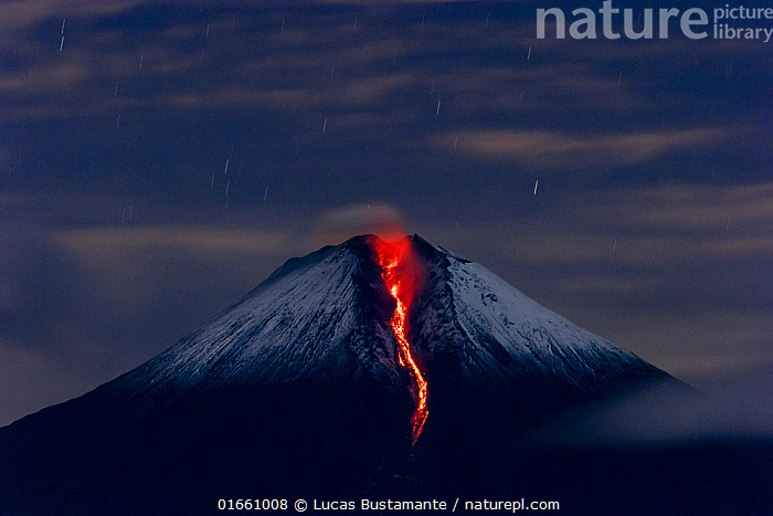 Sangay volcano erupting at night. Sangay National Park, Morona Santiago, Ecuador. June, 2020.  ,  Erupting,Luminosity,Snowcapped,Latin America,South America,Ecuador,Photographic Effect,Long Exposure,Volcano,Stars,Lava,Night,Geology,Volcanic features,  ,  Lucas Bustamante