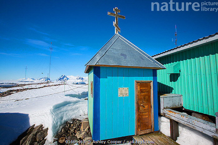 Small chapel in snow, Vernadsky Station Ukrainian research base, Galindez Island, Argentine Islands, Antarctica. 2019.  ,  Colour,Blue,Size,Small,Antarctica,Antarctic,Polar,Symbol,Spiritual Symbol,Cross,Building,Place Of Research,Research Facility,Research Facilities,Church,Churches,Wilhelm Archipelago,Argentine Islands,Galindez Island,  ,  Ashley Cooper