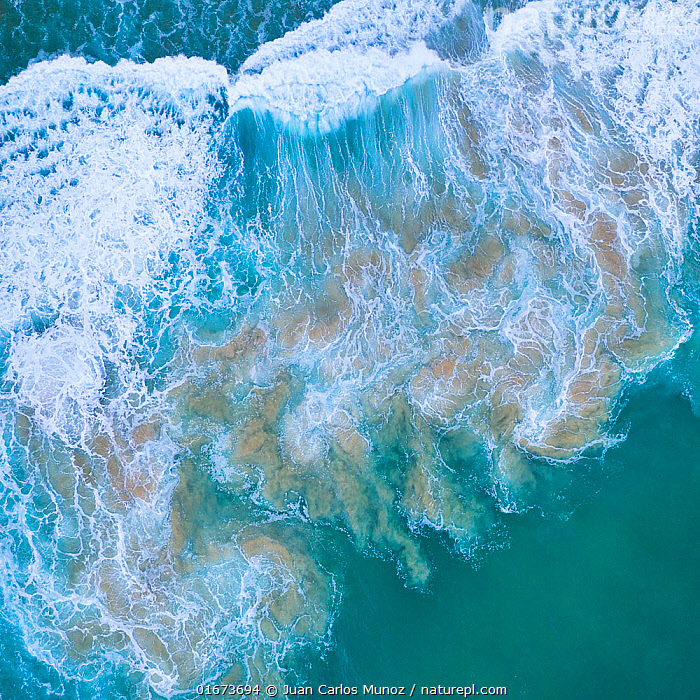 Aerial view of the sea over Antuerta beach, Trasmiera Coast. Cantabrian Sea, Cantabria, Spain. January 2020.  ,  Colour,Blue,Europe,Southern Europe,Spain,Aerial View,High Angle View,Ocean,Atlantic Ocean,Wave,Coast,Marine,Coastal,Water,Arty shots,Saltwater,Sea,Elevated view,Drone,Drone shot,Bay of Biscay,Cantabrian Sea,  ,  Juan Carlos Munoz