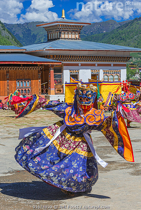 Dance of terrifying deities. Haa Tsechu festival at the 'white chapel'. Cham, or Masked dance. Bhutan. September 2013.  ,  People,Asian Ethnicity,Asian,Asians,Traditional,Colour,Colourful,Celebration Event,Occasion,Occasions,Festival,Asia,Indian Subcontinent,Bhutan,Clothing,Headdress,Mask,Masks,Traditional Clothing,Local people,  ,  Jeff Foott