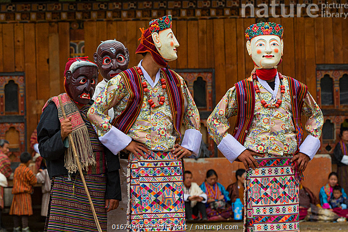 Haa Tsechu festival at the 'white chapel'. The Pholay Molay masked dance (the dance of the noble men and ladies). Bhutan. September 2013.  ,  People,Asian Ethnicity,Asian,Asians,Traditional,Celebration Event,Occasion,Occasions,Festival,Asia,Indian Subcontinent,Bhutan,Art,Sculpture,Sculptures,Statue,Clothing,Headdress,Mask,Masks,Traditional Clothing,Local people,  ,  Jeff Foott