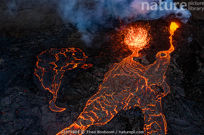 Aerial view of the lava streams and the two craters at the eruption site, Fagradalsfjall volcano, Iceland, 2 April 2021  ,  Erupting,Colour,Orange,Europe,Northern Europe,North Europe,Nordic Countries,Scandinavia,Iceland,Aerial View,High Angle View,Volcano,Lava,Geology,Volcanic features,Elevated view,Drone,Drone shot,Lava flow,  ,  Theo  Bosboom
