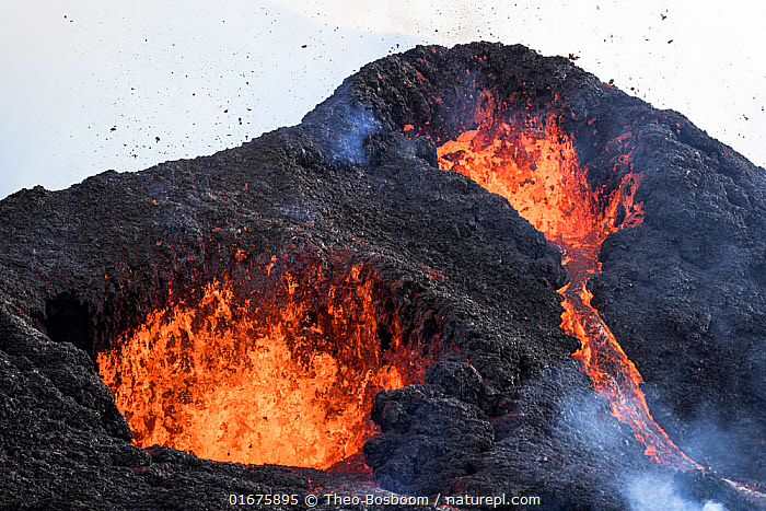 Two craters of the Fagradalsfjall volcano spitting out lava continously, Iceland, 4 April 2021.  ,  Erupting,Colour,Orange,Europe,Northern Europe,North Europe,Nordic Countries,Scandinavia,Iceland,Volcano,Geology,Volcanic features,  ,  Theo  Bosboom