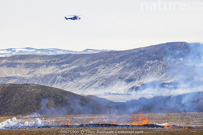 Helicopter hovering over the a new fissure that opened at April 5, 2021, about 700 meters from the original site of the eruption. 5 April 2021  ,  Iceland,,,Erupting,Danger,Europe,Northern Europe,North Europe,Nordic Countries,Scandinavia,Iceland,Aircraft,Helicopters,Volcano,Geology,Volcanic features,Fissure,Fault,  ,  Theo  Bosboom
