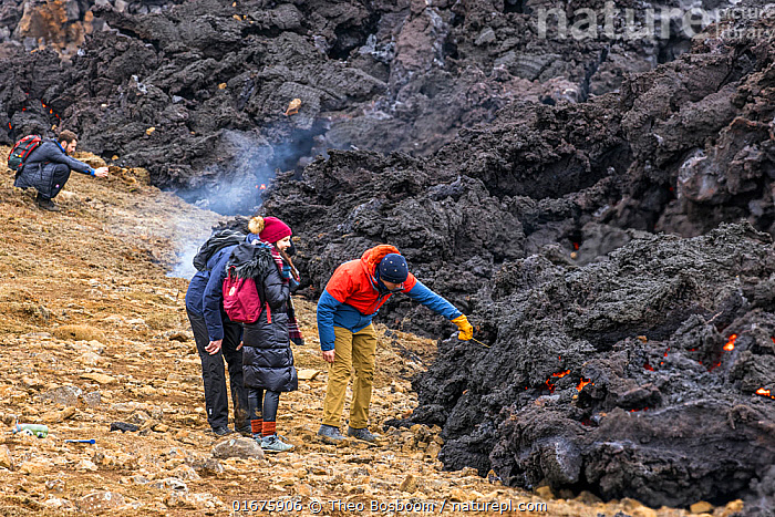 Group of tourists are grilling marshmallows on lava flow, Fagradalsfjall volcano, Iceland. Although many people are doing this, it is not entirely without risk, especially in areas with large lava towers that could collapse without any warning. 1 April 2021.  ,  Enjoyment,Fun,Europe,Northern Europe,North Europe,Nordic Countries,Scandinavia,Iceland,Volcano,Lava,Travel,Tourism,Geology,Volcanic features,Lava flow,  ,  Theo  Bosboom