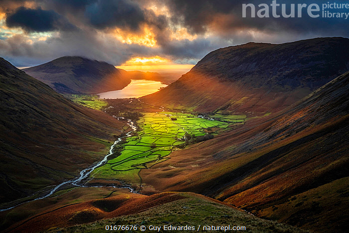 Evening sunlight illuminating Wasdale Head and Wast Water from Great Gable, Lake District National Park, Cumbria, England, UK. December 2020  ,  Europe,Western Europe,UK,Great Britain,England,Cumbria,Hill,Mountain,Sunlight,Light Ray,Beautiful,Lake district,Natural Light,  ,  Guy Edwardes