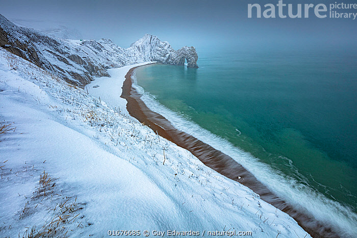 Durdle Door in winter during Strom Emma, Jurassic Coast World Heritage Site, Isle of Purbeck, Dorset, England, UK. March 2018  ,  Europe,Western Europe,UK,Great Britain,England,Dorset,Rock Formations,Arch,Arches,Snow,Landscape,Winter,Coast,Marine,Coastal,Water,Geology,Saltwater,Sea,Isle of Purbeck,Landform,  ,  Guy Edwardes