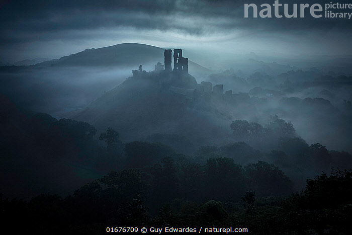 Corfe Castle at dawn, Isle of Purbeck, Dorset, England, UK. September 2013  ,  Mood,Gloomy,Mystery,Europe,Western Europe,UK,Great Britain,England,Dorset,Building,Historic Building,Castle,Castles,Sky,Cloud,Mist,Landscape,Dawn,Isle of Purbeck,  ,  Guy Edwardes