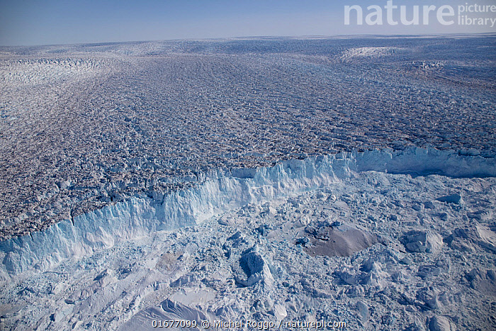 Aerial view of the front of the Sermeq Kujalleq Glacier, Greenland, entering the Kangia Ilulissat Icefjord full of icebergs. The icebergs are produced by the Sermeq Kujalleq Glacier, one of the fastest (up to 40 m a day) and most active glaciers in the world; its annual calving is over 46 km3 of ice, 10% of all Greenland calf ice~UNESCO World Heritage Site, Kalaallit Nunaat (Greenland) August 2019~Photographed for The Freshwater Project  ,  COP26,,,Aerial View,High Angle View,Ice,Glacier,Iceberg,Icebergs,Protected area,UNESCO World Heritage Site,Elevated view,Freshwater Project,Kalaallit Nunaat,,COP26  ,  Michel Roggo